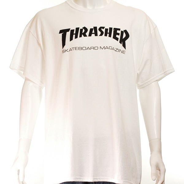 This image has a white background, and features a white Thrasher OG logo t-shirt. The t-shirt is modelled on a male mannequin, and there is only the top-half of its body in the image. The t-shirt is short sleeved, coming to just above the elbow, with a central screen-printed graphic which says 'Thrasher' in a large bold text the same as Thrasher magazines branding the magazine front cover, underneath which in a non-bold and smaller font it says 'skateboard magazine'. All the lettering in capital letters and is black.